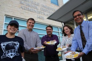 PACE students serve PEF and PCDC Board members from their new food trailer.